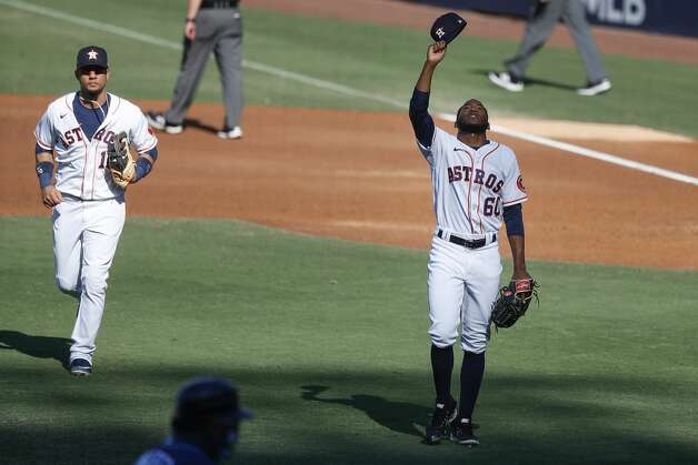 Houston Astros Yuli Gurriel (10) and relief pitcher Enoli Paredes leave the field after Paredes got Tampa Bay Rays Yandy Diaz to ground out to end the third inning of Game 5 of the American League Championship Series at Petco Park Thursday, Oct. 15, 2020, in San Diego. Photo: Karen Warren/Staff Photographer / © 2020 Houston Chronicle