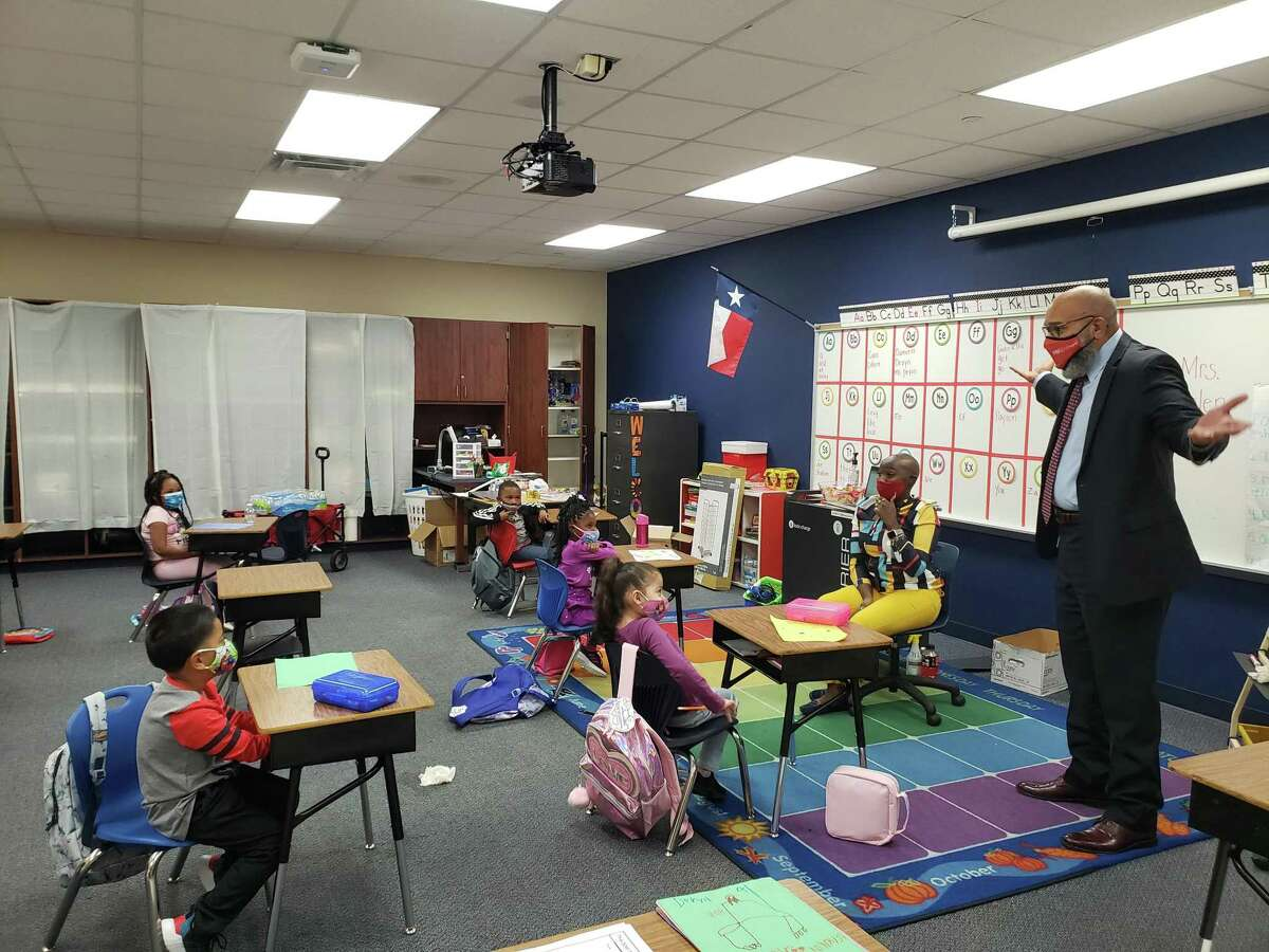 Fort Bend ISD superintendent Charles Dupre visits with students at Jones Elementary School on the first day of classes after schools re-opened.