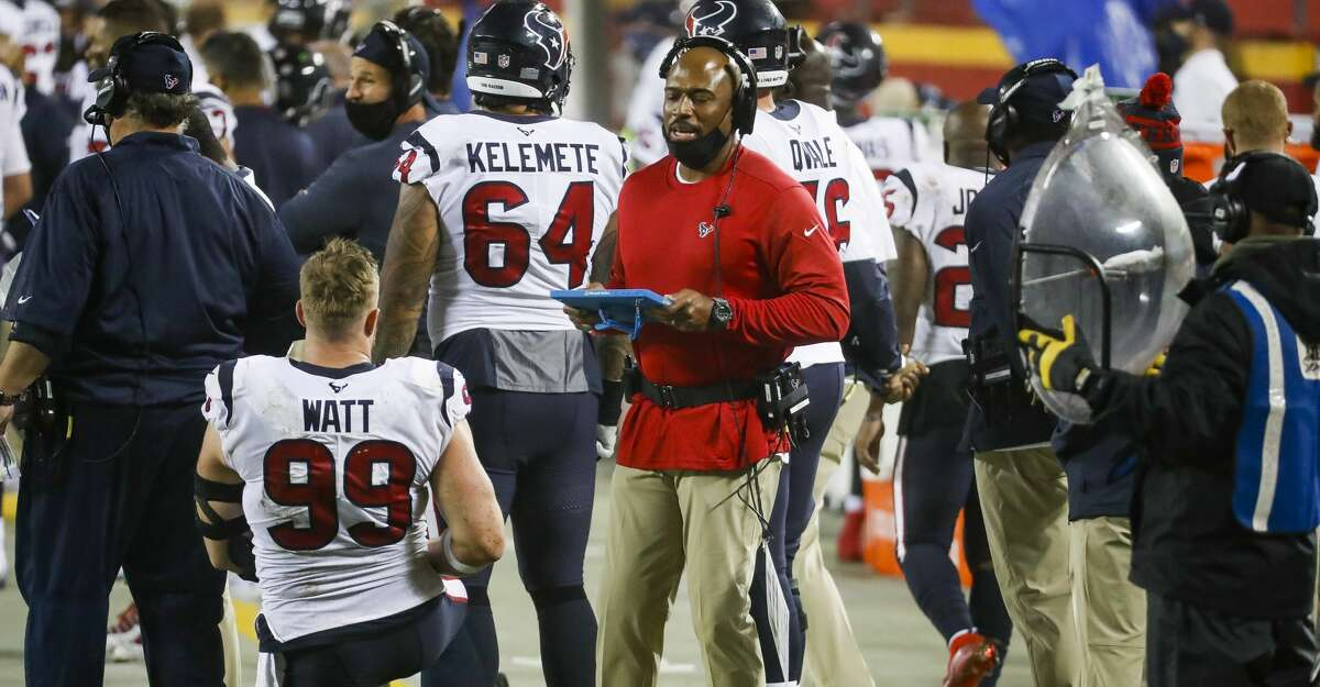 Houston Texans defensive coordinator Anthony Weaver talks with Houston Texans defensive end J.J. Watt (99) during the third quarter of an NFL football game on Thursday, Sept. 10, 2020, at Arrowhead Stadium in Kansas City.