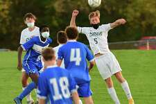 Shenendehowa's Owen Brignati, #5, heads the ball during a soccer game against Shaker on Thursday, Oct. 15, 2020 in Latham, N.Y. (Lori Van Buren/Times Union)