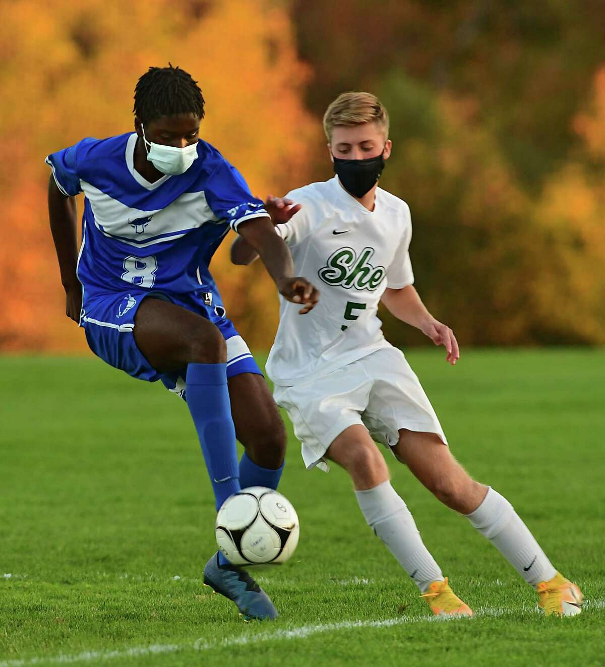 Shaker's Jaaziel Olayinka, left, and Shenendehowa's Owen Brignati battle during a soccer game on Thursday, Oct. 15, 2020 in Latham, N.Y. (Lori Van Buren/Times Union)