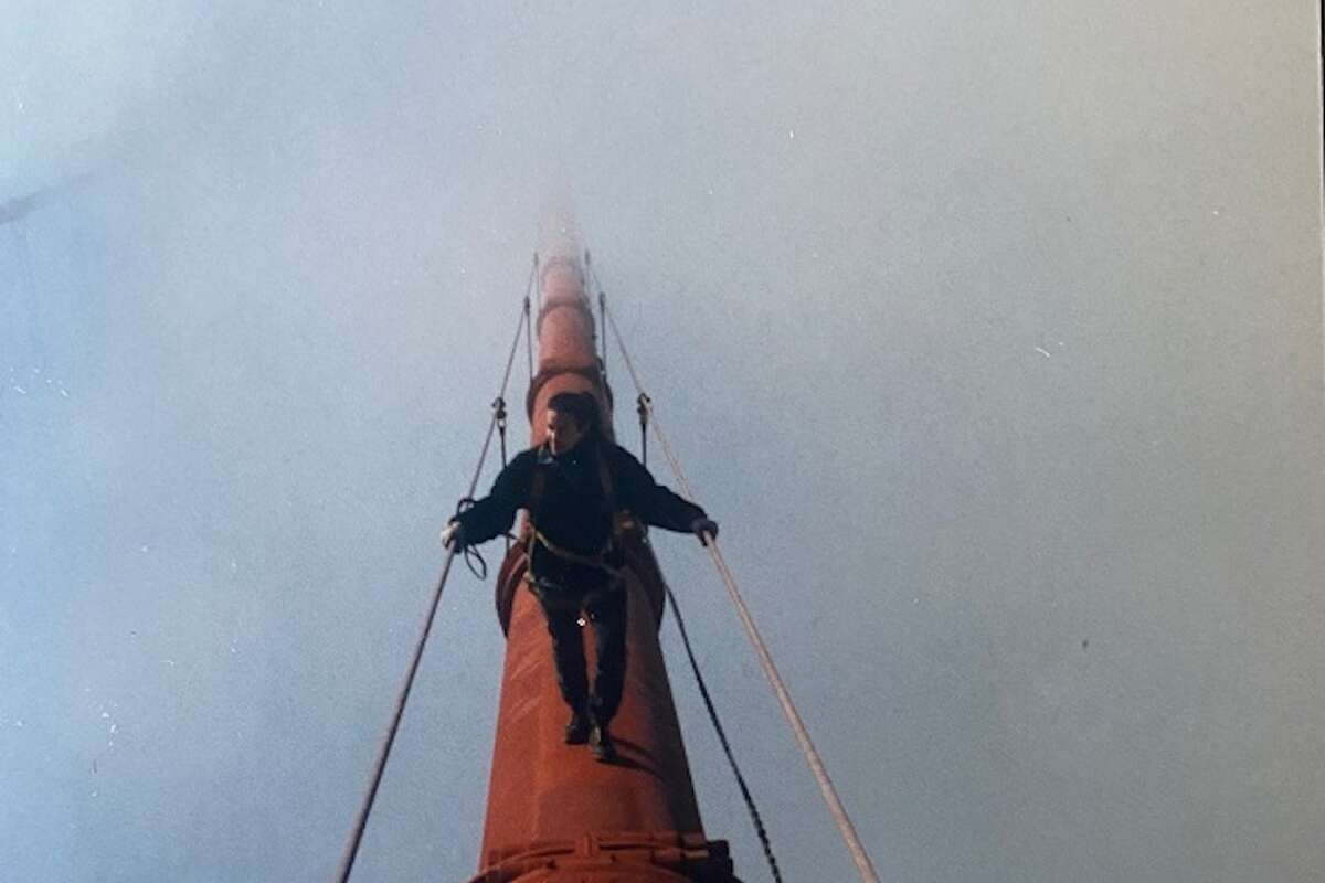 Diana Coopersmith walking the main cable of the Golden Gate Bridge.