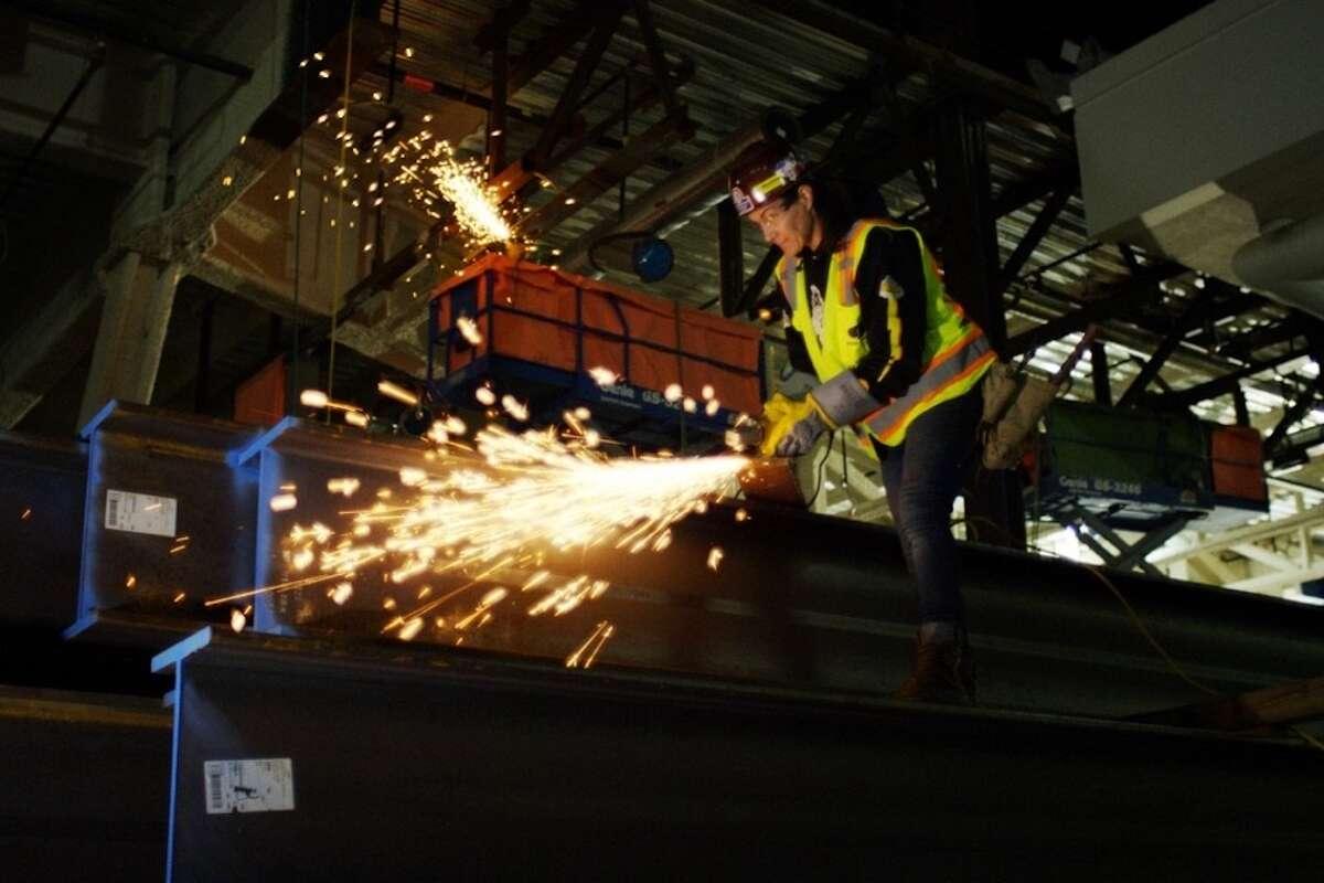 Diana Coopersmith at work welding.