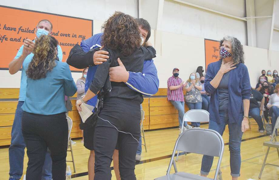 A supporter hugs former Waverly Elementary School Principal Tammy Hermes after she spoke Wednesday during a Waverly school board meeting. Photo: Rochelle Eiselt | Journal-Courier