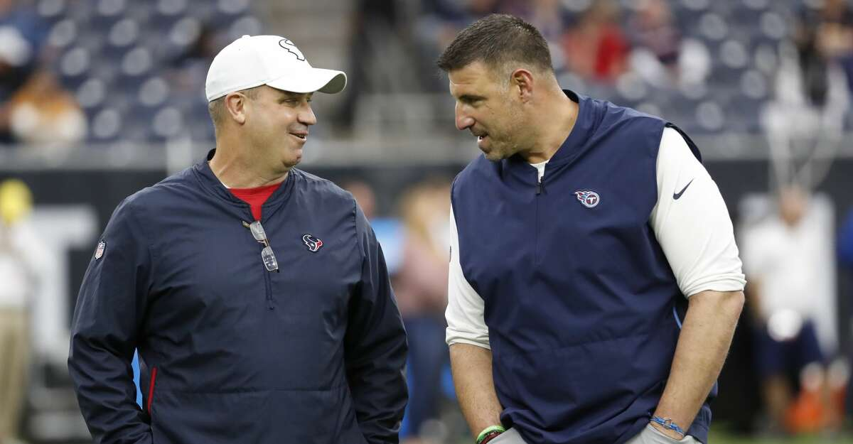 Houston Texans head coach Bill O'Brien and Tennessee Titans head coach Mike Vrabel talk before an NFL football game at NRG Stadium on Sunday, Dec. 29, 2019, in Houston.