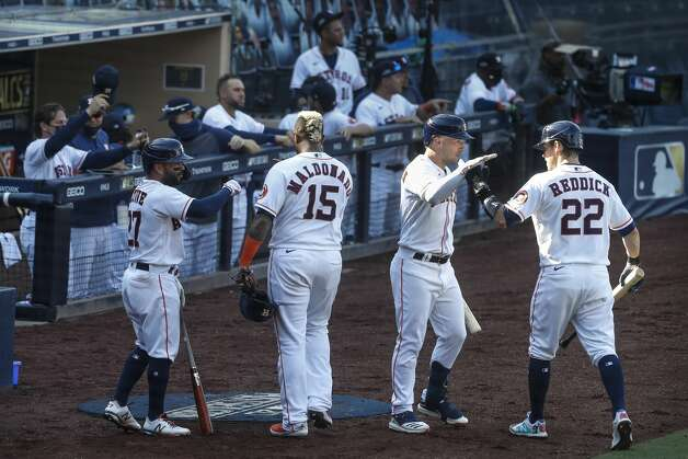 Houston Astros Jose Altuve, left, Martin Maldonado (15), Alex Bregman and Josh Reddick (22) celebrate in front of the dugout after Maldonado and Reddick scored on a 2-run double by Michael Brantley during the third inning of Game 5 against the Tampa Bay Rays in the American League Championship Series at Petco Park Thursday, Oct. 15, 2020, in San Diego. Photo: Karen Warren/Staff Photographer / © 2020 Houston Chronicle