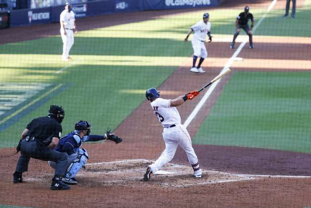 Houston Astros Michael Brantley (23) hits a 2-run double against the Tampa Bay Rays during the third inning of Game 5 of the American League Championship Series at Petco Park Thursday, Oct. 15, 2020, in San Diego. Photo: Karen Warren/Staff Photographer / © 2020 Houston Chronicle
