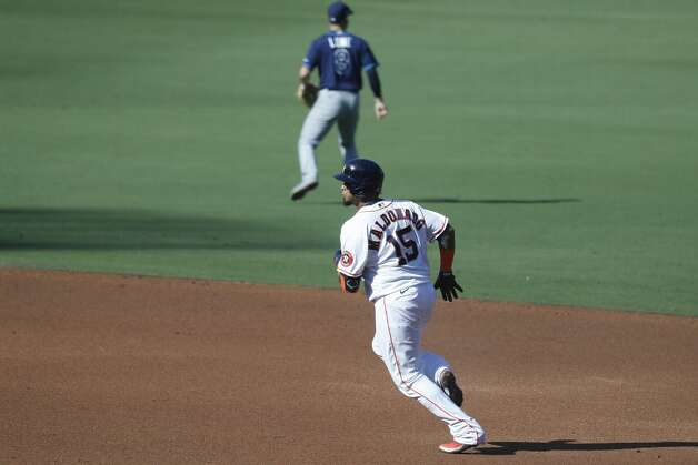 Houston Astros Martin Maldonado (15) runs past Tampa Bay Rays Brandon Lowe (8) after hitting a double during the third inning of Game 5 of the American League Championship Series at Petco Park Thursday, Oct. 15, 2020, in San Diego. Photo: Karen Warren/Staff Photographer / © 2020 Houston Chronicle
