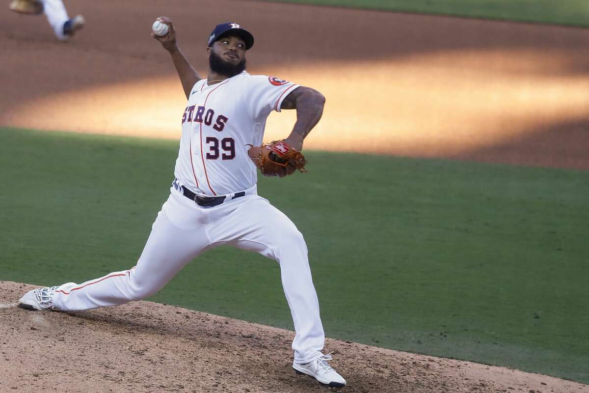 Houston Astros Josh James pitches against the Tampa Bay Rays during the seventh inning of Game 5 of the American League Championship Series at Petco Park Thursday, Oct. 15, 2020, in San Diego.