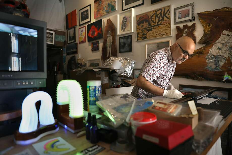 Gallery owner/artist John Lindsey works on packaging prints at the Great Highway Gallery on Tuesday, Oct. 13, 2020, in San Francisco, Calif. Photo: Liz Hafalia / The Chronicle
