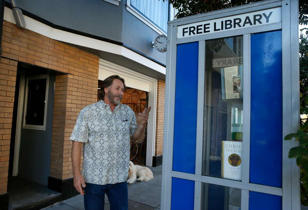 Jay Streets offers his S.F. garage as a polling station on election day. In addition, he operates a year-round free library and book drop inside a decommissioned phone booth in front of his building.