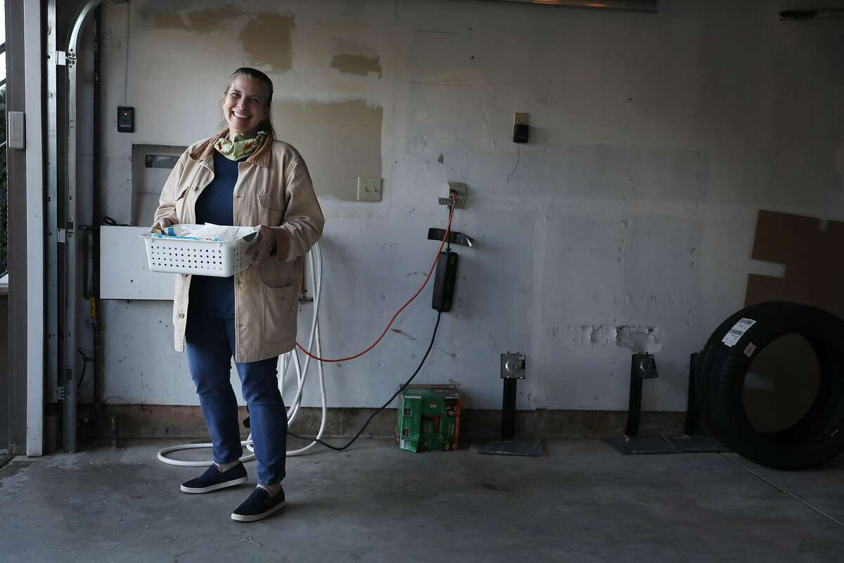 Lisa Gautier, who has volunteered her S.F. garage as an election day polling place for years, cleans up the space.