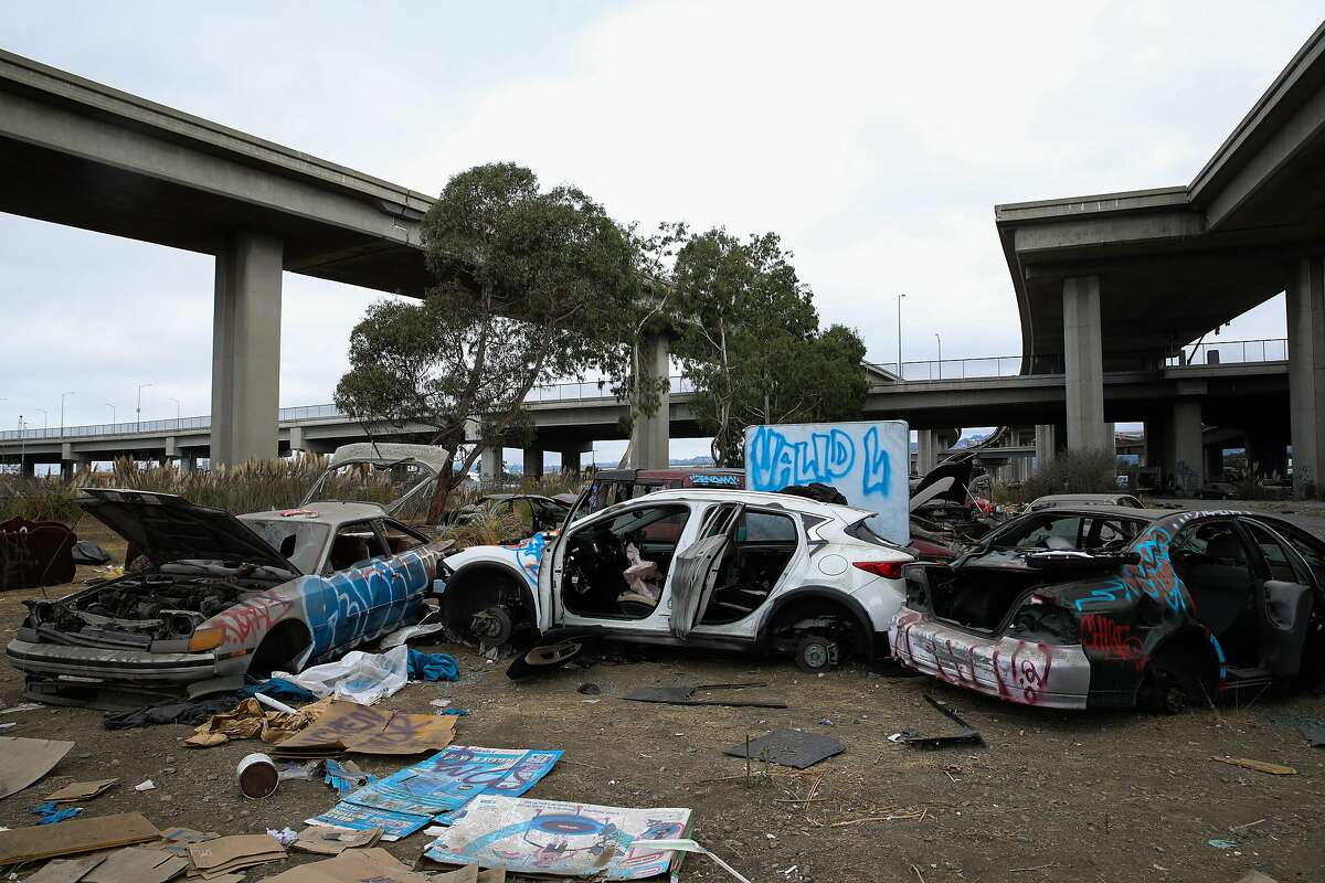 Destroyed cars clutter the Wood Street encampment in Oakland.