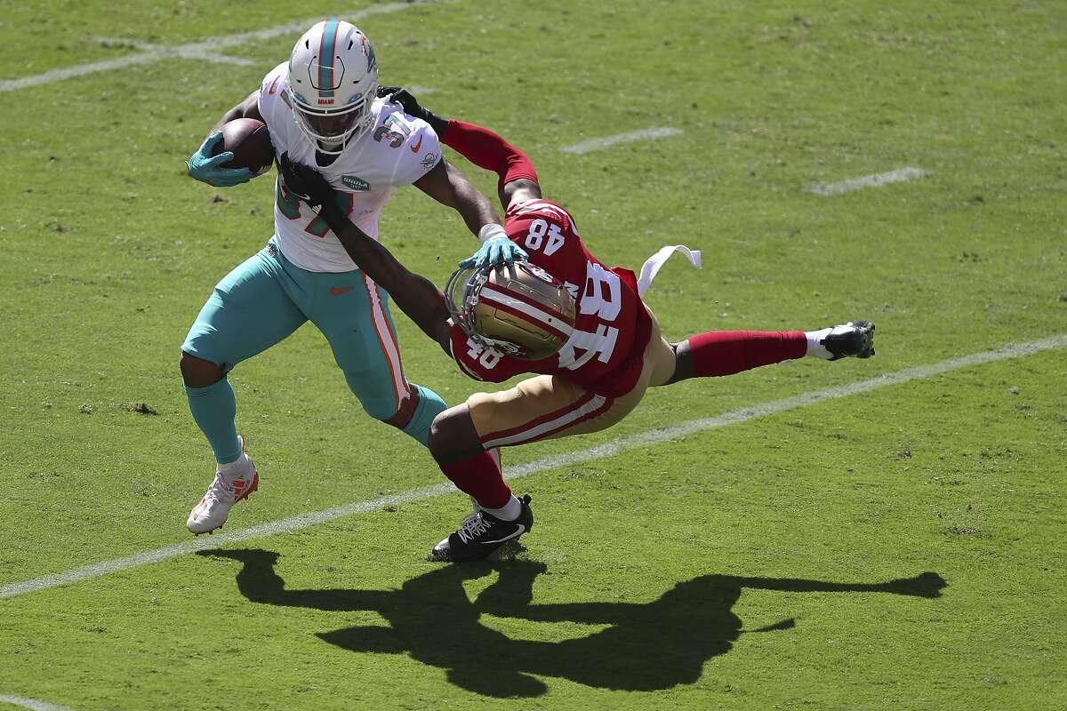 Miami Dolphins running back Myles Gaskin (37) runs against San Francisco 49ers cornerback Brian Allen (48) during the first half of an NFL football game in Santa Clara, Calif., Sunday, Oct. 11, 2020. (AP Photo/Jed Jacobsohn)