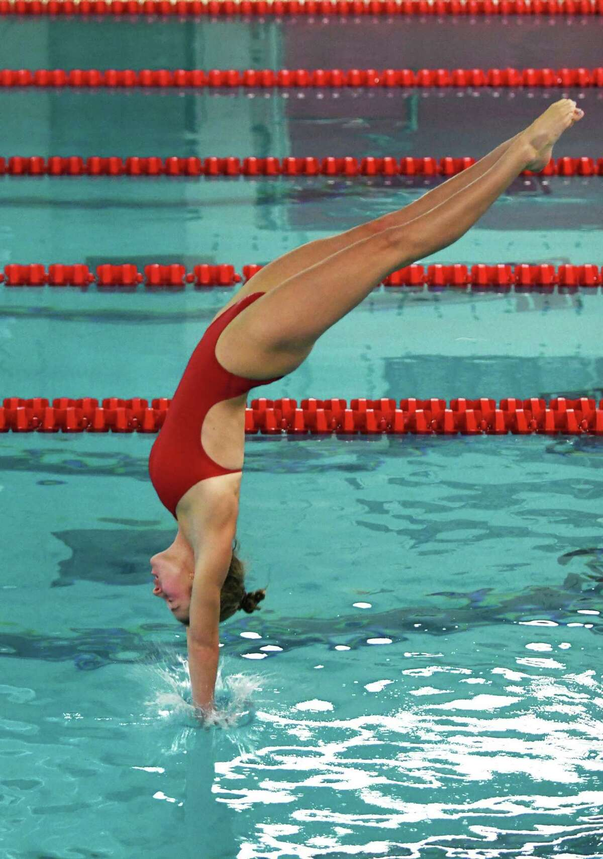 Greenwich's Annie Bingle dives during her first-place performance in the high school girls swim meet between Darien and Greenwich at Greenwich High School in Greenwich, Conn. Thursday, Oct. 15, 2020.