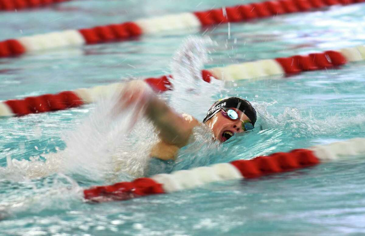 Greenwich's Meghan Lynch wins the 200 meter freestyle event at the high school girls swim meet between Darien and Greenwich at Greenwich High School on Thursday.