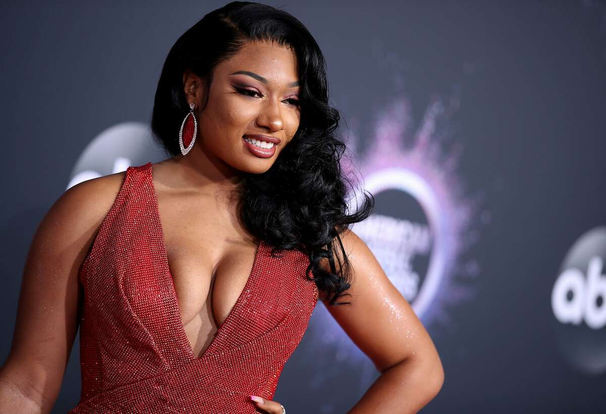 FILE - OCTOBER 08: Rapper Tory Lanez has been charged with felony assault over shooting Megan Thee Stallion in July. He has additionally been charged with carrying a loaded, unregistered firearm, also a felony. If convicted he faces 22 years and eight months in prison. LOS ANGELES, CALIFORNIA - NOVEMBER 24: Megan Thee Stallion attends the 2019 American Music Awards at Microsoft Theater on November 24, 2019 in Los Angeles, California. (Photo by Rich Fury/Getty Images)