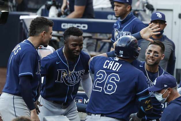 Tampa Bay Rays Ji-Man Choi (26) celebrates his game tying solo home run off Houston Astros Josh James during the eighth inning of Game 5 of the American League Championship Series at Petco Park Thursday, Oct. 15, 2020, in San Diego. Photo: Karen Warren/Staff Photographer / © 2020 Houston Chronicle