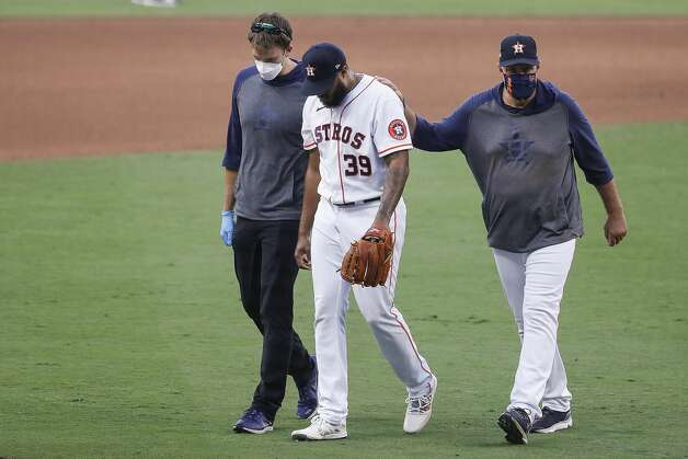 Houston Astros Josh James (39) leaves the field after suffering an injury during the eighth inning of Game 5 of the American League Championship Series against the Tampa Bay Rays at Petco Park Thursday, Oct. 15, 2020, in San Diego. Photo: Karen Warren/Staff Photographer / © 2020 Houston Chronicle