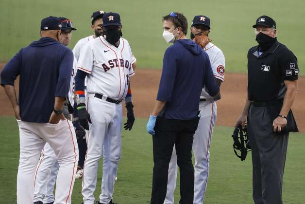 Houston Astros manager Dusty Baker, Jr., and the Astros medical staff checks on reliever Josh James after James suffered an injury during the eighth inning against the Tampa Bay Rays in Game 5 of the American League Championship Series at Petco Park Thursday, Oct. 15, 2020, in San Diego. Photo: Karen Warren/Staff Photographer / © 2020 Houston Chronicle