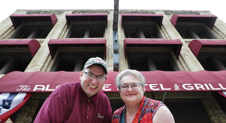Don Page Jr., current owner, and Deidra Voigt, former owner of the the Alcalde Hotel. Voigt's grandparents built the facility, which is the first historical franchise for the OYO chain. Photo: Bob Owen / San Antonio Express-News / ©2020 San Antonio Express-News