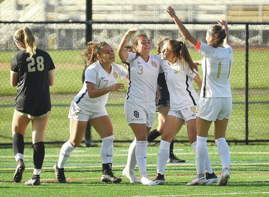 St. Joseph teammates celebrate a first half goal by Andriana Cabral, center, during their girls soccer match at rival Trumbull High School in Trumbull, Conn. on Thursday, October 15, 2020. Photo: Brian A. Pounds / Hearst Connecticut Media / Connecticut Post