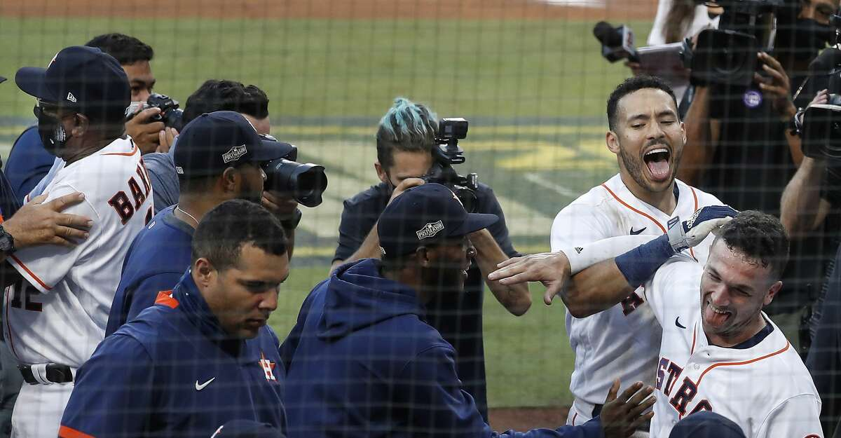 Astros teammates Carlos Correa (top right) and Alex Bregman celebrate Correa's walkoff home run off Tampa Bay Rays reliever Nick Anderson during the ninth inning of Game 5 of the American League Championship Series at Petco Park Thursday, Oct. 15, 2020, in San Diego. The Astros won 4-3, closing the gap in the best-of-seven series to 3 games to 2.