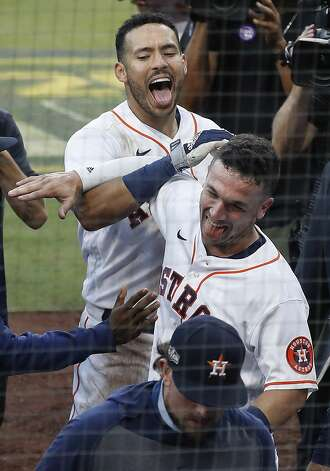 Houston Astros Carlos Correa (1) and Alex Bregman celebrate Correa's walk off home run off Tampa Bay Rays reliever Nick Anderson during the ninth inning of Game 5 of the American League Championship Series at Petco Park Thursday, Oct. 15, 2020, in San Diego. The Astros won 4-3, closing the gap in the best-of-seven series to 3 games to 2. Photo: Karen Warren/Staff Photographer / © 2020 Houston Chronicle