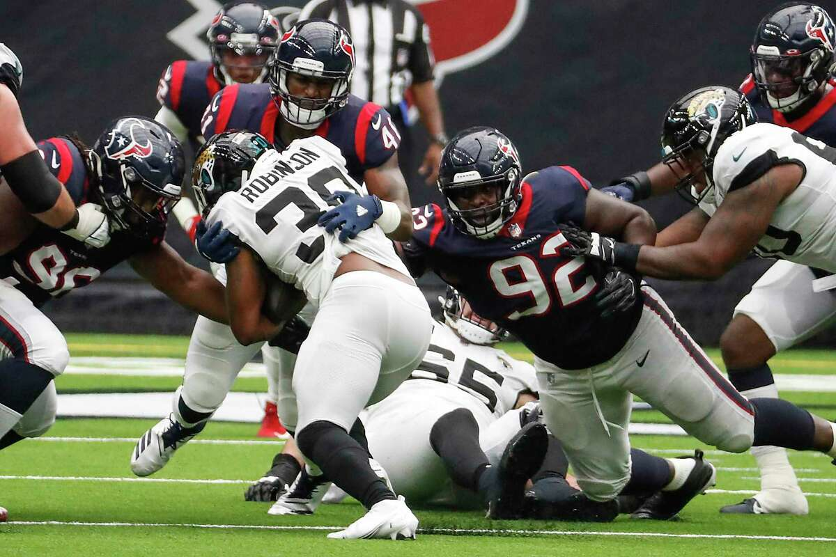 Houston Texans inside linebacker Zach Cunningham (41) stops Jacksonville Jaguars running back James Robinson (30) at the line of scrimmage during the third quarter of an NFL football game at NRG Stadium on Sunday, Oct. 11, 2020, in Houston.