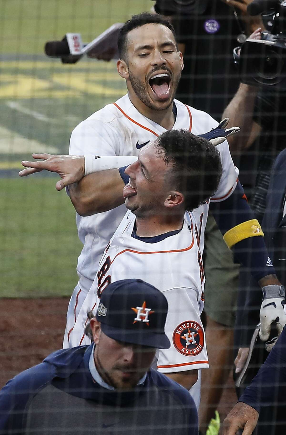 Houston Astros Carlos Correa (1) and Alex Bregman celebrate Correa's walk off home run off Tampa Bay Rays reliever Nick Anderson during the ninth inning of Game 5 of the American League Championship Series at Petco Park Thursday, Oct. 15, 2020, in San Diego. The Astros won 4-3, closing the gap in the best-of-seven series to 3 games to 2.