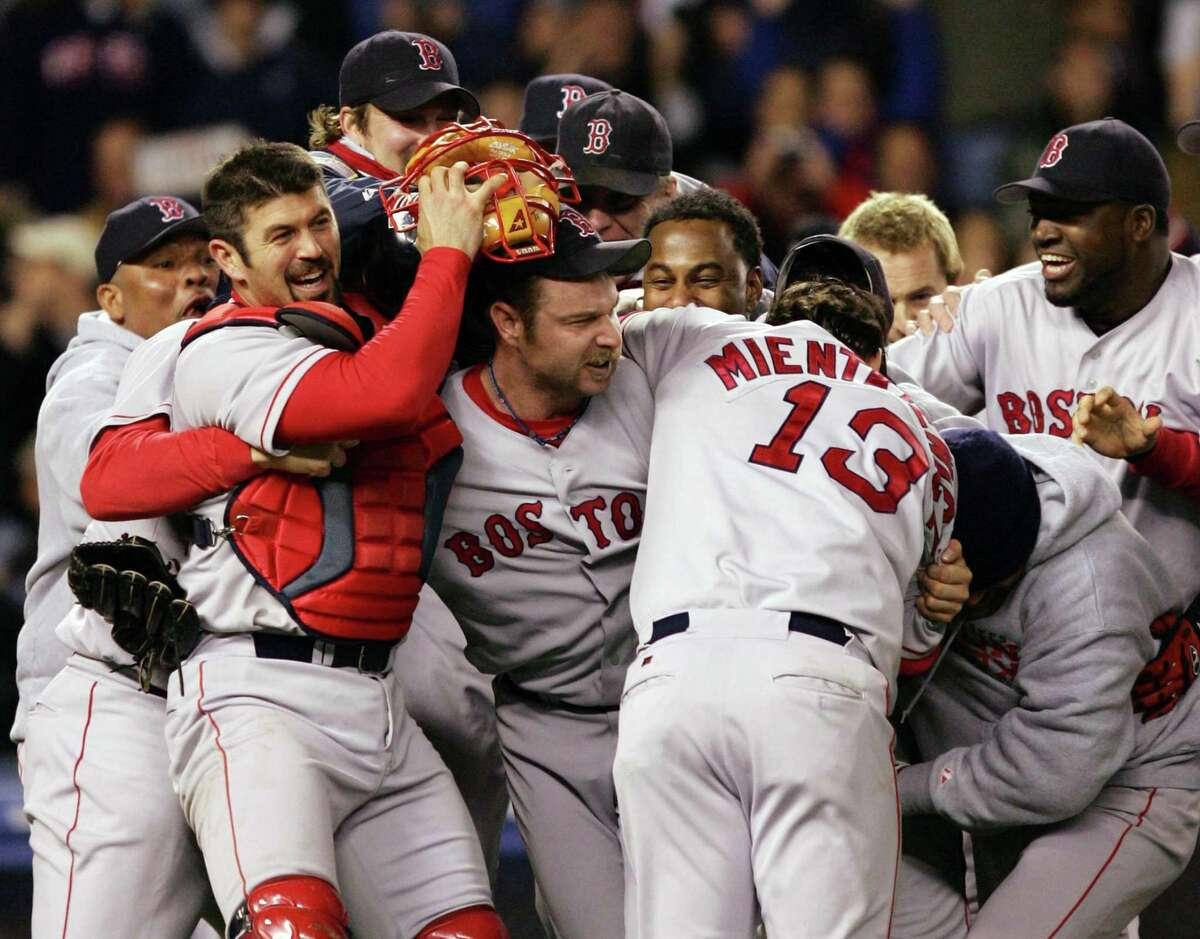 The 2004 Red Sox celebrate their American League pennant-clinching win over the Yankees, who had won the first three games of the ALCS before losing four in a row.