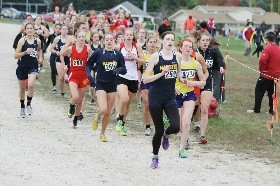 Manistee's Olivia Holtgren (front) and Cecilia Postma are among the leaders of the pack at the start of Thursday's race at Manistee. (Dylan Savela/News Advocate)