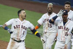 Houston Astros Carlos Correa celebrates with his teammates after hitting a walk off home run off Tampa Bay Rays reliever Nick Anderson during the ninth inning of Game 5 of the American League Championship Series at Petco Park Thursday, Oct. 15, 2020, in San Diego.