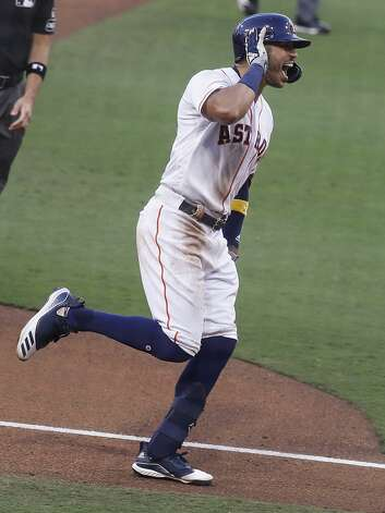 Houston Astros Carlos Correa rounds third with his hand to his ear after hitting a walk off solo home run off Tampa Bay Rays reliever Nick Anderson during the ninth inning of Game 5 of the American League Championship Series at Petco Park Thursday, Oct. 15, 2020, in San Diego. Photo: Karen Warren/Staff Photographer / © 2020 Houston Chronicle