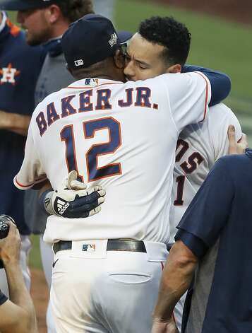 Houston Astros Carlos Correa embraces manager Dusty Baker, Jr. (12) as they celebrate Correa's walk off home run off Tampa Bay Rays reliever Nick Anderson during the ninth inning to win Game 5 of the American League Championship Series 4-3 at Petco Park Thursday, Oct. 15, 2020, in San Diego. Photo: Karen Warren/Staff Photographer / © 2020 Houston Chronicle