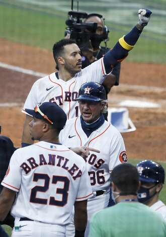 Houston Astros Carlos Correa celebrates with his teammates after hitting a walk off home run off Tampa Bay Rays reliever Nick Anderson to win Game 5 of the American League Championship Series 4-3 at Petco Park Thursday, Oct. 15, 2020, in San Diego. Photo: Karen Warren/Staff Photographer / © 2020 Houston Chronicle