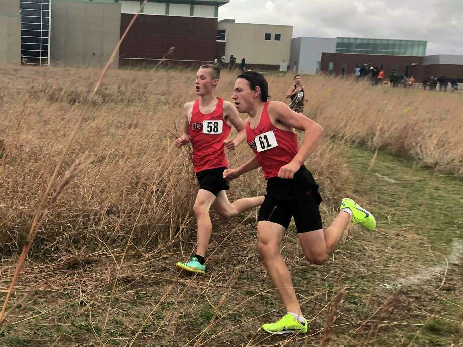 Reed City's Ryan Allen and Anthony Kiaunis work on their pace during Thursday's cross country race at Manistee. (Courtesy photo'John Raffel)