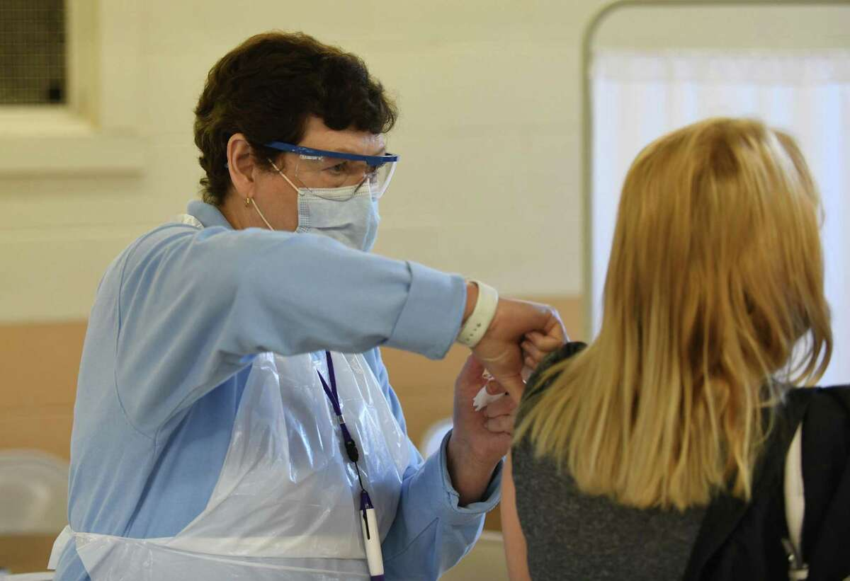 A nurse administers a flu shot at the Eastern Greenwich Civic Center in Old Greenwich, Conn. Wednesday, Oct. 14, 2020.