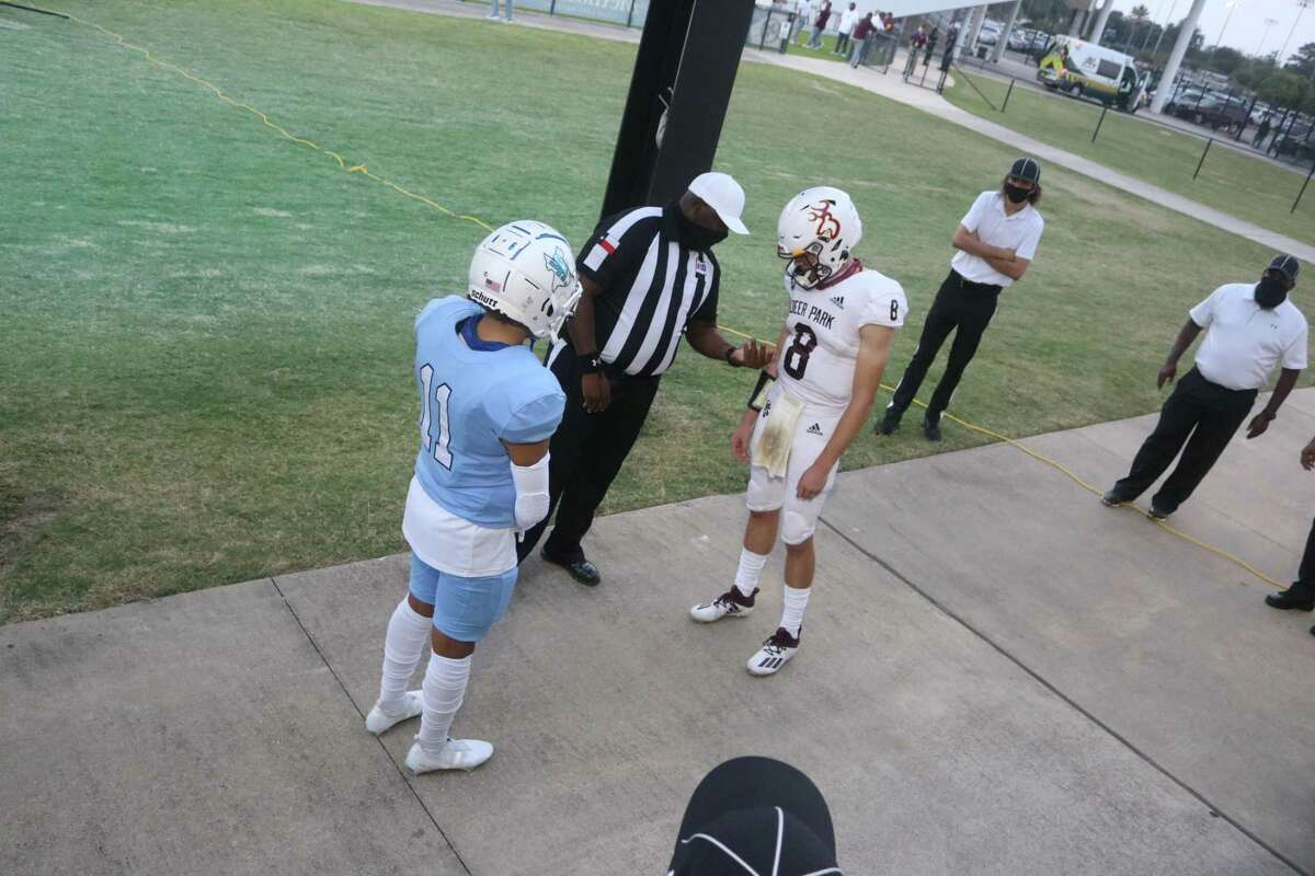 Deer Park's Matthew Potts and Rayburn's Javier Navarro get ready for the pregame coin flip Thursday night. Deer Park won the flip and deferred to the second half.