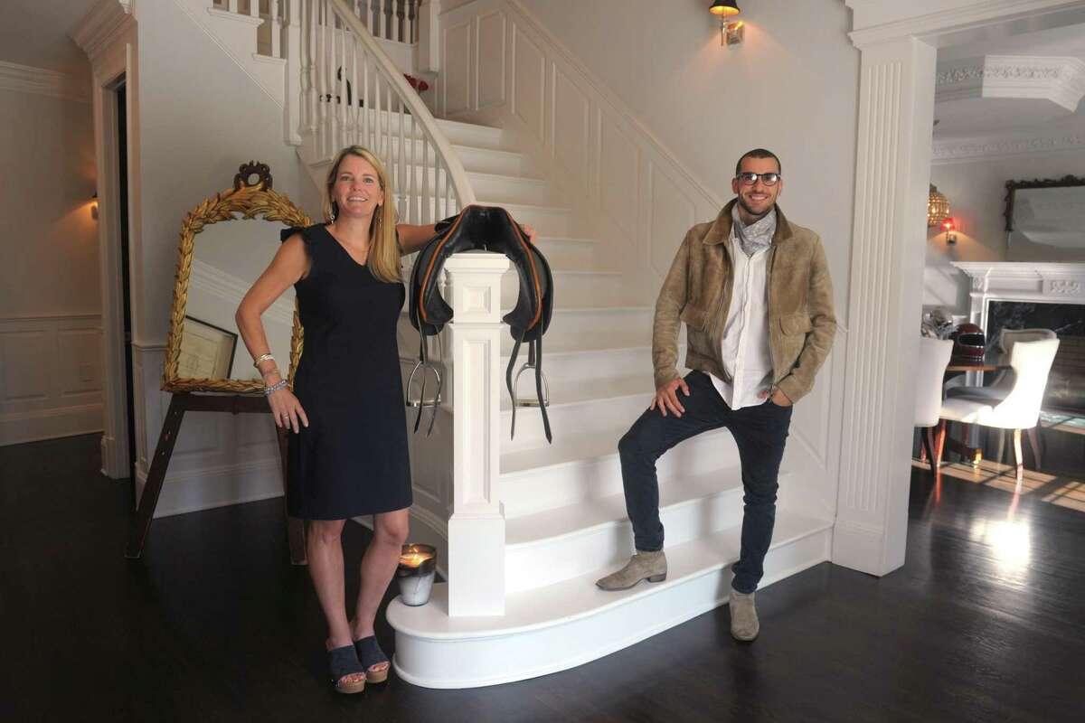 Realtor Tara Hawley and Real Estate Broker Steve Gold pose in the foyer of 115 Senate Lane, in Fairfield, Conn. Oct. 15, 2020.