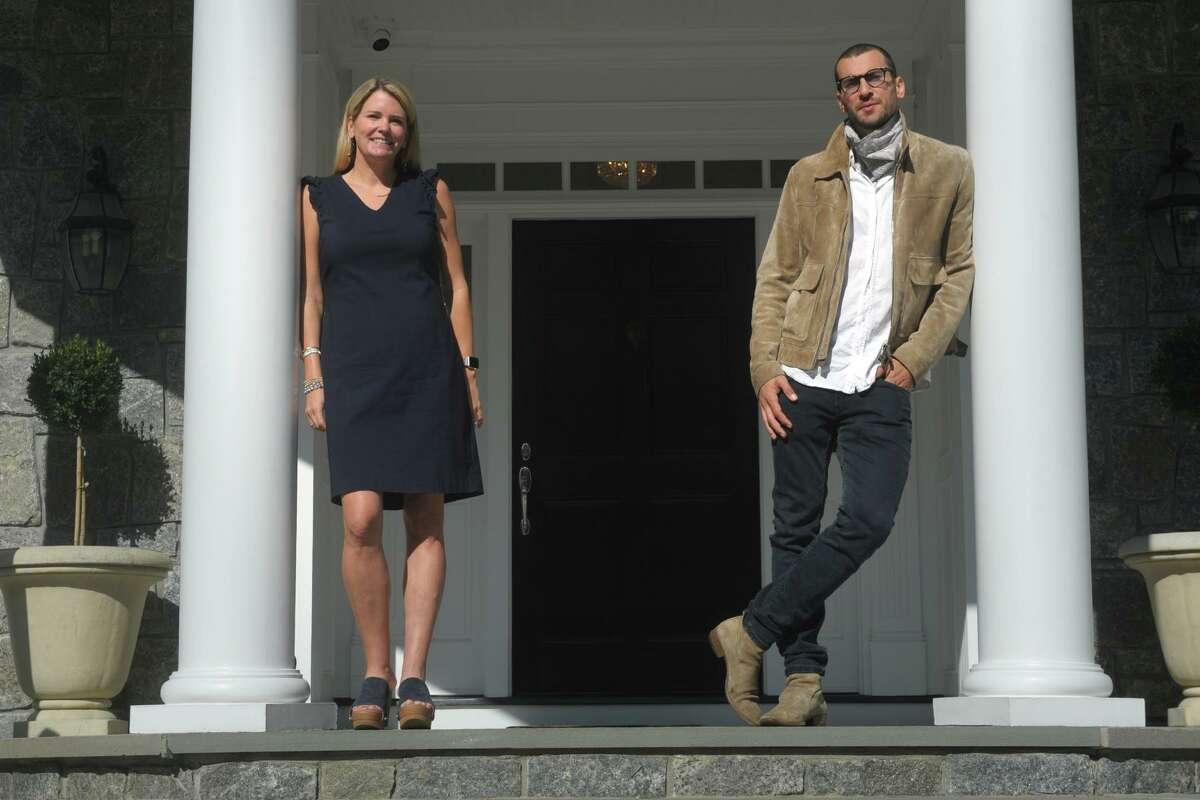 Realtor Tara Hawley and Real Estate Broker Steve Gold pose in front of 115 Senate Lane, in Fairfield, Conn. Oct. 15, 2020.
