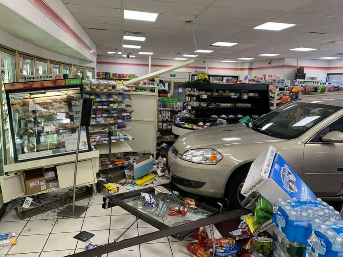 A driver crashed through the doors of a 7-Eleven in South Windsor, Conn., on Wednesday, Oct. 14, 2020.