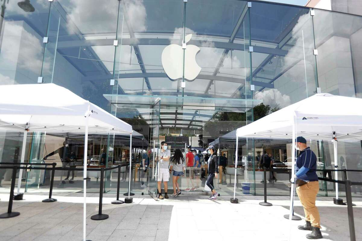 Apple set up tents to screen customers, as customers lined up at Highland Village Apple Store, in Houston, Wednesday, May 27, 2020, as Apple opened up for the first time since the pandemic.