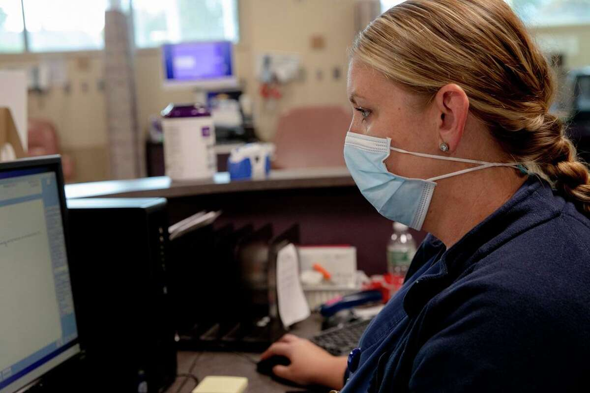 Kristin Levine, a registered nurse, checks a patient's information before making a call to confirm an appointment on Thursday, Oct. 1 at Bristol Hospital. Connecticut is one of the few states that don't have a singular place where every medical practitioner involved with a patient can access that person's health information. Connecticut has been working on that system for over a decade and plans to finally launch one this fall.