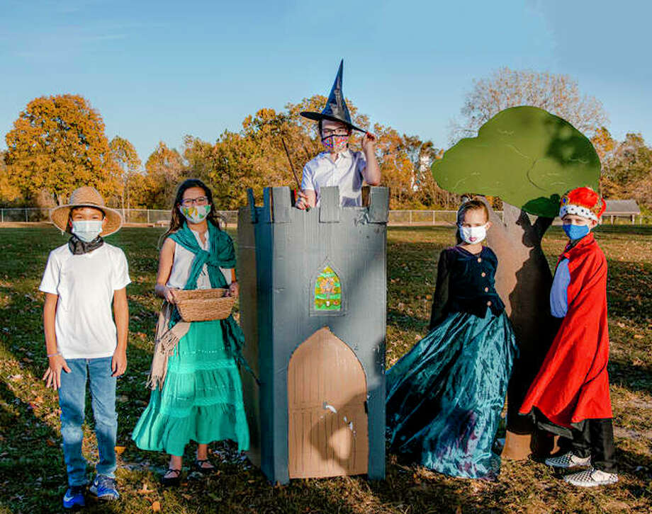 Left to right, Mark Hill, Chloe Kurzym, Maive Durkeey, Maggie Hertz and Spencer Kimmey stand in full costume on set Wednesday. Photo: Tyler Pletsch | The Intelligencer