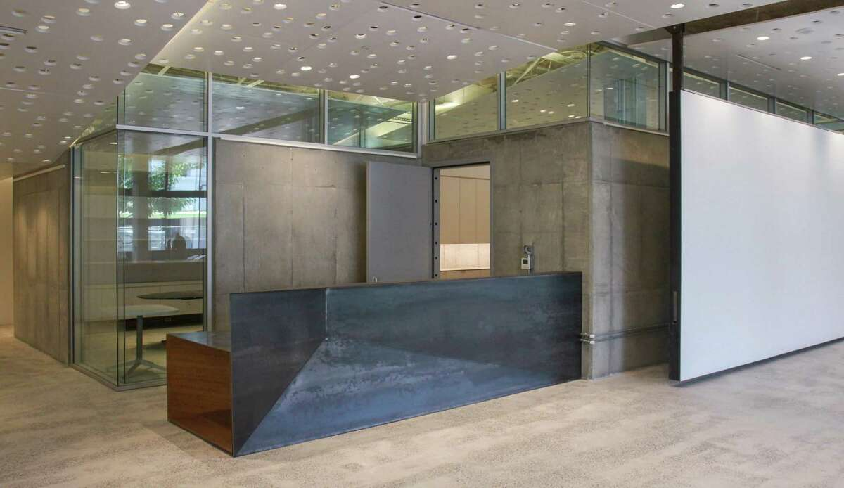 The reception desk was designed by Murphy Mears Architects and created by Houston artist George Sacaris and Brochsteins.