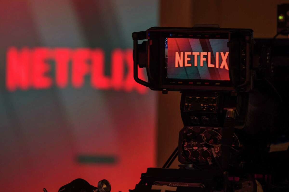A television camera focuses on the Netflix logo in this arranged photograph in London on June 26, 2018.