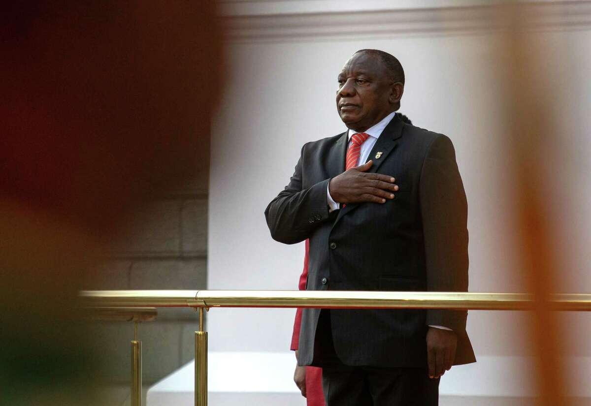 Cyril Ramaphosa, South Africa's president, stands for the national anthem during the state of the nation ceremony in the national assembly in Cape Town, South Africa, on Feb. 13, 2020.