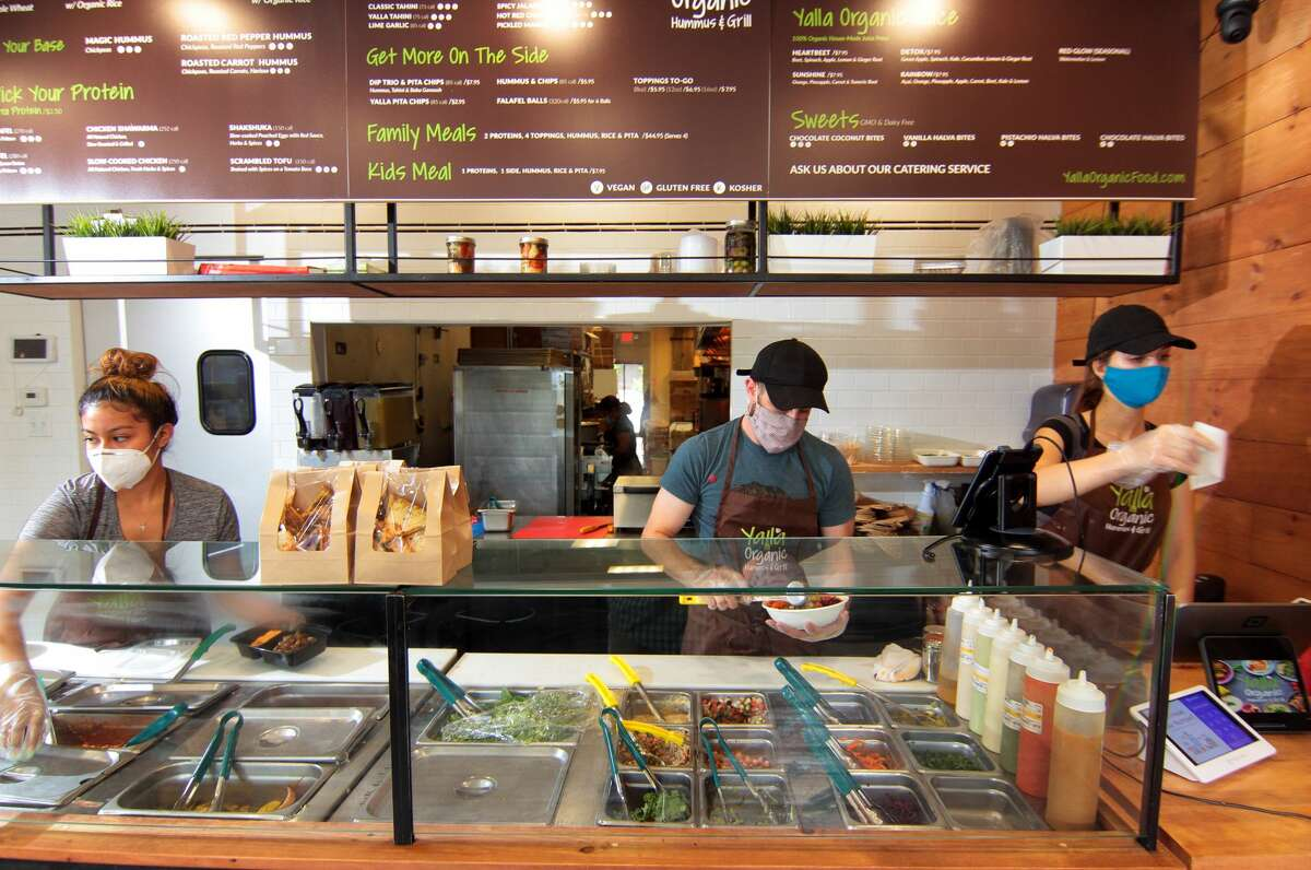 Yalla Organic Hummus & Grill in Fairfield, Conn., on Wednesday Sept. 2, 2020. From left to right is employee Litzy Damian, owner Idan Mitchel and employee Katie Mound. Eat in or take out? While Yalla has some limited indoor seating and ample outdoor seating for those who want to eat on-premise, carry-out business has always been the restaurant's focus. We've opted for takeout or delivery during our trips. Yalla works with all the major delivery services in Fairfield and surrounding towns, and the food carries well.