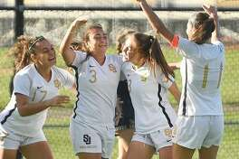 St. Joseph celebrate a first half goal by Andriana Cabral, center, during their girls soccer match at rival Trumbull.